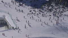 Aerial view of a crowd of people located on a piste skiing at a music Stock Footage