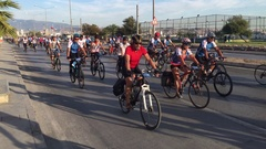 Many people ride on bikes in city traffic Stock Footage