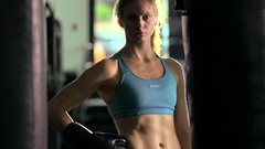 Portrait of a woman before doing Muay Thai kickboxing training at the gym, slow Stock Footage