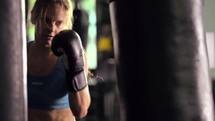 Woman doing Muay Thai kickboxing training at the gym, super slow motion. Stock Footage