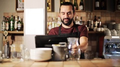 Happy man or waiter at cashbox in coffee shop Stock Footage