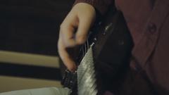 Man plays electric guitar Stock Footage