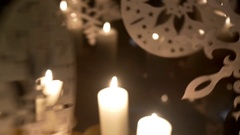 Advent white candles over that revolve decorations made of plywood dep Arkistovideo