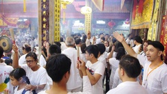 People in White with Incense Sticks Praying in Chinese Temple Stock Footage