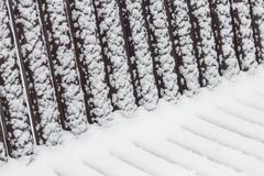 Abstract geometric patterns on a snowy bench Stock Photos