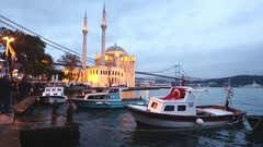 Ortakoy mosque and Bosphorus bridge in Istanbul at dusk, Turkey Stock Footage