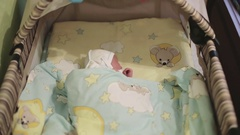 A newborn lays in the children bed. Stock Footage