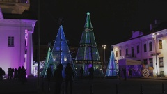 Glowing Christmas trees in the square Stock Footage