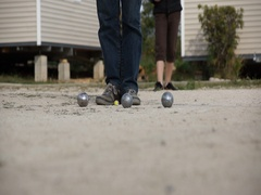 Friends playing bocce ball outside. Stock Footage
