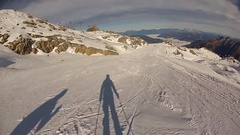 Shadow of skier skiing down a snow covered mountain. Stock Footage