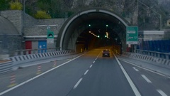 Autocar enters and then go through the tunnel on a highway Stock Footage