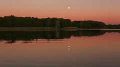 Full moon reflecting in a lake Stock Footage