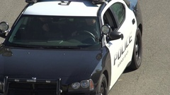Cop car patrolling the streets , slow motion. Stock Footage