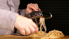 Pasta making machine producing spaghetti. Stock Footage
