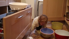 Baby gets up by himself Baby toddler playing with pots and pans Stock Footage