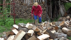 Man with hat chop firewood axe for winter. Work in country. 4K Stock Footage