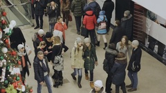 People stand near a Christmas tree in a shopping center Stock Footage