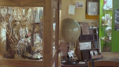 Cute girl in antique shop looking antique jewelry Stock Footage
