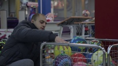 Father buying his son a gift at a toy shop. Stock Footage