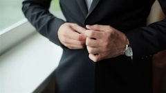 Stylish man dressed in suit buttoning jacket close up Stock Footage