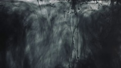 Black paint drops in the water Stock Footage