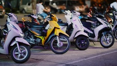 Motorbikes stand in the parking lot at night Stock Footage
