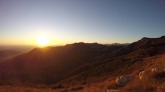 Time lapse fiery sunset from mountain pick with thin glazes in the sky evening. Stock Footage