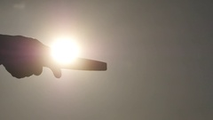 Closeup of sharpening a knife against bright sun Stock Footage