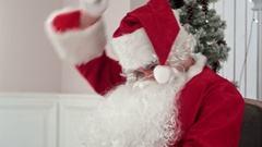 Santa Claus finishing writing and checking his letter to a kid Stock Footage