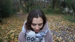 Portrait of a teenage girl outdoor wearing winter coat with the hood on. Girl in Stock Footage