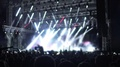 Crowd of people watching fantastic rock star performance on illuminated stage HD Footage