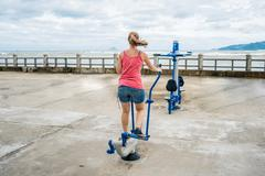 Young woman wanting to lose weight is engaged in the gym Stock Photos