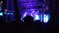 Silhouettes of many people applauding and filming video on phone at concert Stock Footage