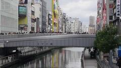 Dotomobori Bridge people taking photos with landmarks  Stock Footage