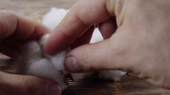 Hands man spun cotton yarn. 4K video. Stock Footage