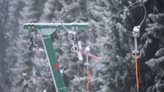 Empty ski lift cable in a ski resort during snowfall Stock Footage