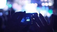 Female hands taking pictures on phone at concert, using gadget to save memories Stock Footage