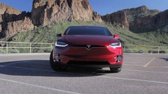 Tesla Model X - Falcon doors opening with Mountains in Background Stock Footage