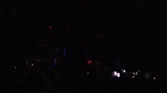 Fantastic light show, illumination flashing on stage, crowd silhouettes dancing Stock Footage