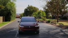 Tesla Model X - Driving in neighborhood Stock Footage