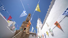 Grecian church with flags in a village (Lindos, rhodes) Stock Footage