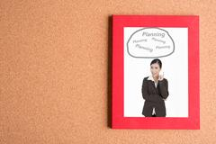 Picture of business woman in frame  with word planning on wooden table Stock Photos