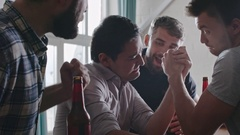 Men Arm Wrestling at Party Stock Footage