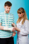 Man with broken hand visit doctor. Stock Photos