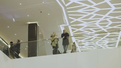 People stand near the railing in the shopping center Stock Footage