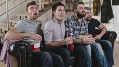 Men Discussing Football Game on TV Stock Footage
