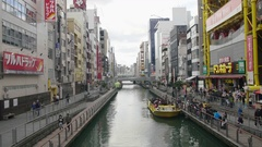 Tourist get off boat on dotombori bridge popular Namba Japan Stock Footage