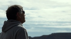 Mature man of 50 years observes the horizon after jogging Stock Footage