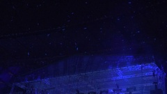 Weightless white feathers flying in air at concert hall, creative decor at show Stock Footage