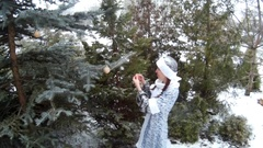 Snow Maiden in forest hanging toys on a firm tree smiling Ukraine scene2 Stock Footage